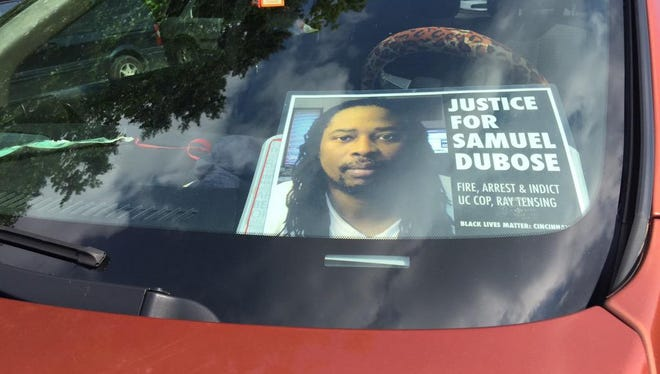 A sign with a picture of Samuel Dubose at the visitation Tuesday.