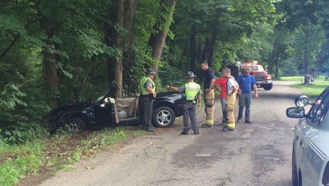 Officers respond at the scene of an injury-related crash at Trego Creek Road.
