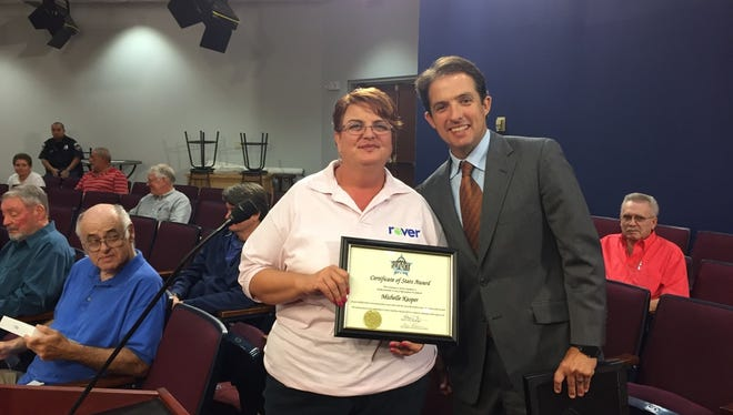 Michelle Kasper, left, is pictured with Murfreesboro Mayor Shane McFarland after the City Council recognized her customer service for Rover bus riders.