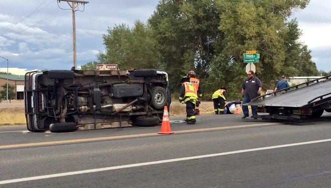 A red Ford Explorer was left on its side Tuesday morning near Fort Collins.