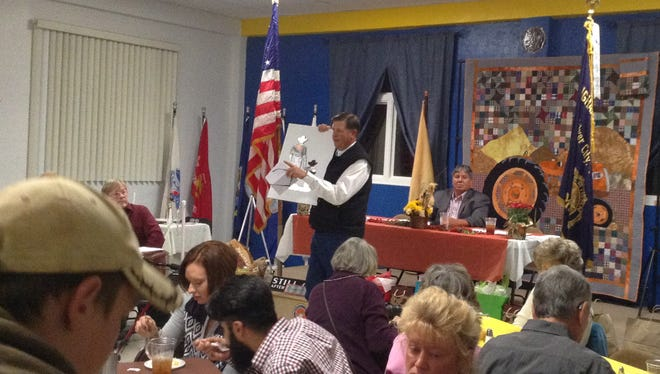 Land Commissioner Aubrey Dunn auctions off an item to benefit 4-H kids at the annual Grant County Farm Bureau dinner on Friday. The Annual Meeting and Banquet was held at the American Legion Hall  in Silver City.