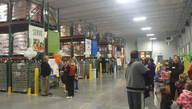 Feeding America representatives welcomed the public to the grand opening of its new Appleton food bank Saturday.