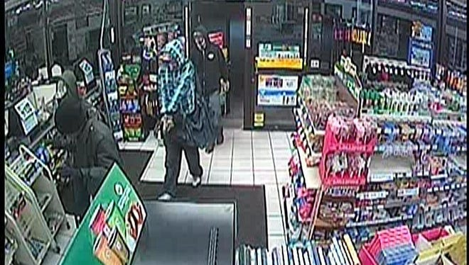 This security camera still shows three suspects police are seeking in connection to an armed robbery of a Fort Collins convenience store.