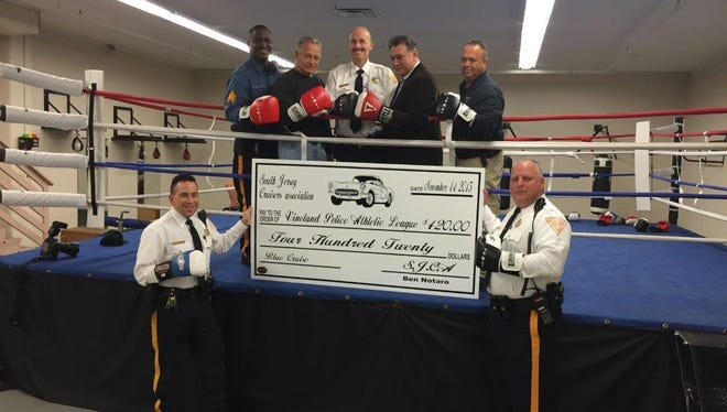 South Jersey Cruisers Association presents a check to the Vineland Police Athletic League on Wednesday.  Back row: (left to right) Sgt. Shane Harris, James Vertolli, Capt. Tom Ulrich, South Jersey Cruisers Association founder Ben Notaro and Officer Al Vargas.  Front row: Lt. Pedro Casiano and Lt. Dave Cardana.