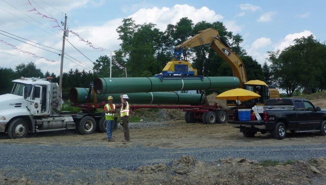 A magnet attached to an excavator removes a segment of 36-inch pipeline that is being installed along Texas Eastern Transmissions' 2.3-mile right-of-way in East Hanover Township, Lebanon County.