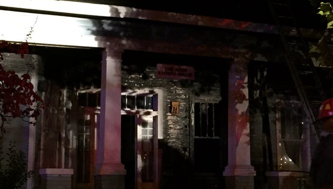 Smoke and fire damage can be seen to the front of the Stewpot's Sims House.