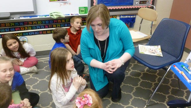Lickdale Elementary School teacher Rebecca Foxwell talks one-on-one with her students in this photo taken in March at the school. Foxwell was named 2016 Pennsylvania Teacher of the Year Monday at  SAS Institute,  the Pennsylvania Department of Education's annual professional development conference, Hershey.