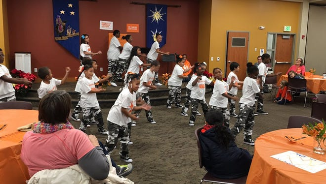 Kids Against Violence perform at orange event on Saturday in Des Moines.