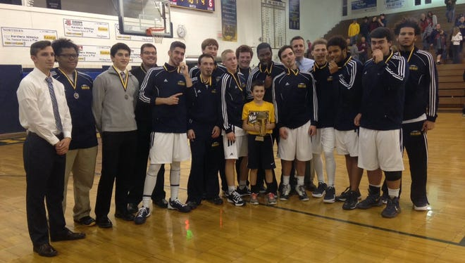 Port Huron Northern poses with their Ed Peltz medals after beating St. Clair, 60-40.