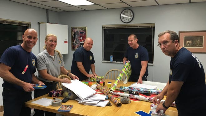 Employees with BCFR wrap items to be donated to families in need.