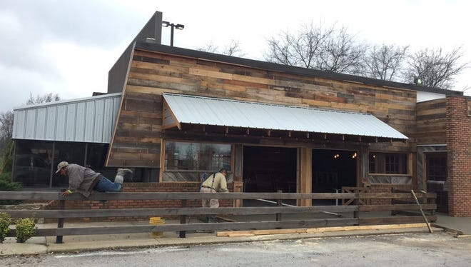 Workers spruce up the planned Jack and Jameson's Smokehouse in Franklin.