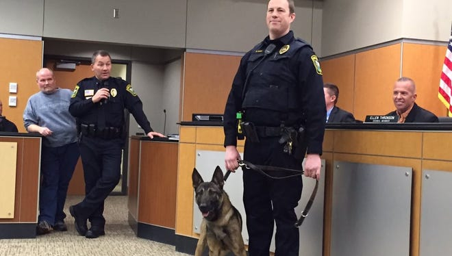 Sauk Rapids Officer Matt Bosma holds the leash of his department's new K-9, Thunder, while Thunder is introduced at the City Council meeting Monday.