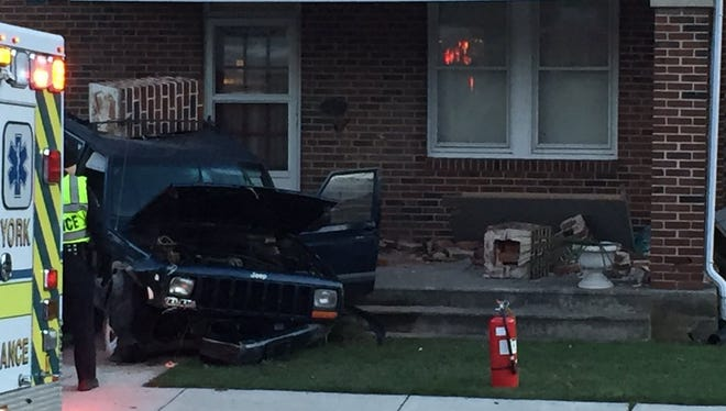 A car crashed into a porch as a result of a multi-vehicle crash in West Manchester Township on Tuesday.