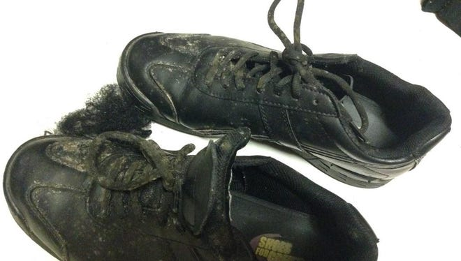Many residents' personal items, such as Dasy Vazquez's work shoes, were damaged by mold that grew over winter break.
