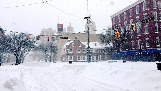A look at Continental Square in York on Saturday, as snow continued to fall in the area. Despite the travel ban, at least five businesses in downtown York opened for part of the day.