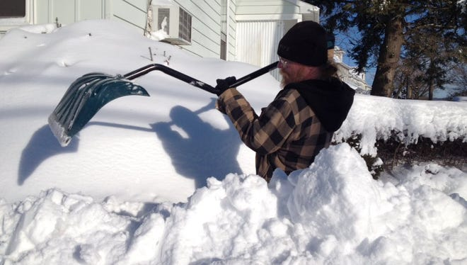 Mike Heck starts the digging out process near Ridge Avenue in Hanover on Sunday.