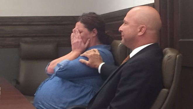 April Grissom reacts after a Lamar County jury found her not guilty of second-degree murder in the death of Louis Betz.