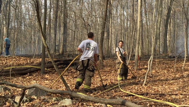 Fire crews worked to contain a large brush fire Thursday in Conewago Township. The fire broke out in the woods along Bremer Road.