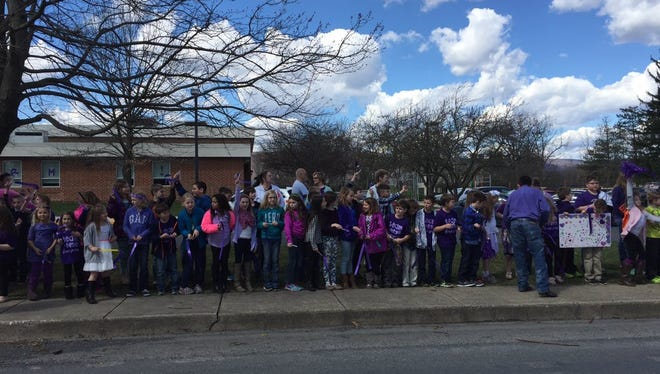 Tuscarora School District students line the street as they await Reese's arrival.