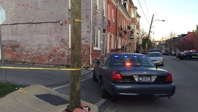 Police investigate a shooting on the 400 block of South Queen Street in York.