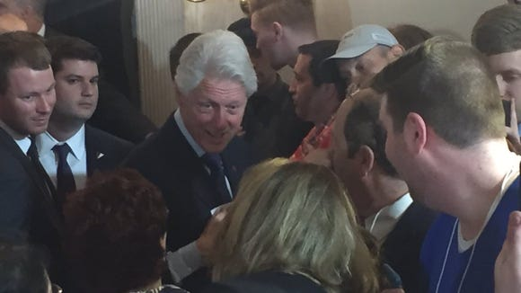 President Bill Clinton greets supporters in suburban