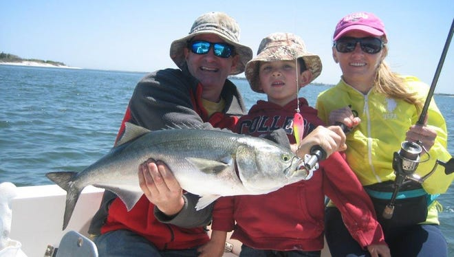 Joe Koz, his son Lucas, 5, and Anna Ferrara with the bluefish Lucas caught on a topwater plug in Barnegat Bay on the charter boat Hi Flier.