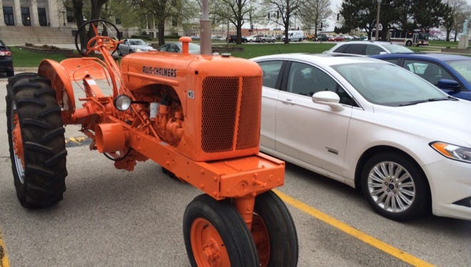 Rep. Rob Taylor, R-West Des Moines, parks his tractor in the Iowa Capitol parking lot.