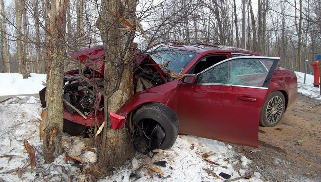 This photo released by the Iron County Sheriff's Department in Michigan shows a car driven by a 19-year-old man that crashed into a tree on April 21, 2013. Investigators said the driver was drunk and speeding.