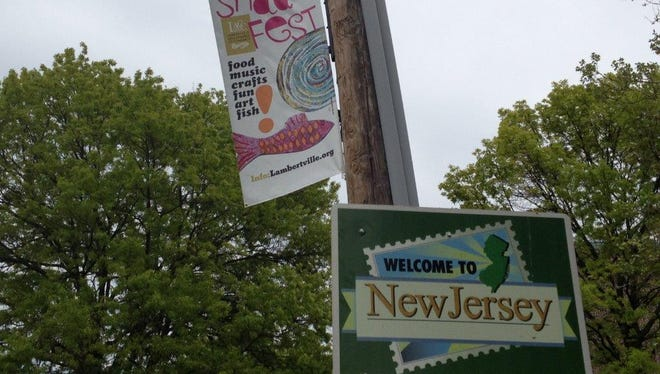 A street banner advertises the Shad Fest in this file photo.