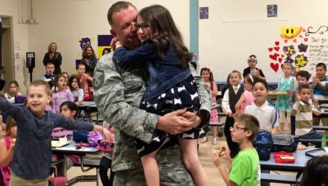 Air Force Master Sgt. James Avery surprises his daughter Violet and her classmates when he went to the Evans Elementary School school as soon as he arrived home from deployment in Afghanistan.