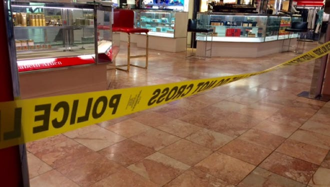 Crime scene tape is seen inside the Macy's at the Silver City Galleria mall in Taunton, Mass., Tuesday, May 10, 2016. Multiple people have been stabbed separate attacks at the mall and a home in Massachusetts.