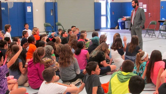 Moustafa Aldouri, an Iraqi refugee, spoke with the seventh-graders at DeMasi Middle School on April 22.