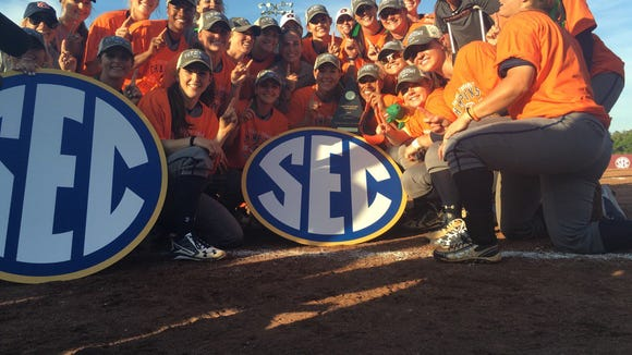 Auburn softball team celebrates its 2016 Southeastern Conference Tournament in Starkville, Miss., after a 7-1 win over LSU.