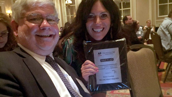 The Enquirer Editor-in-Chief, Peter Bhatia, and reporter Sharon Coolidge at the Associated Press Media Editors award ceremony in Columbus on Sunday.