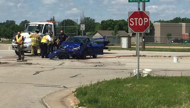 Crews clear the scene of a two-vehicle crash in Kaukauna on Sunday afternoon.