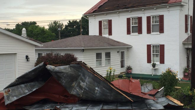 Part of a roof was ripped from a Spring Grove house during a hail storm Tuesday morning.