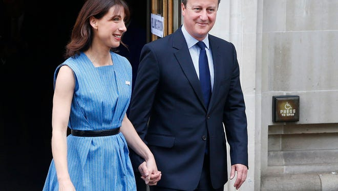 British Prime Minister David Cameron and his wife, Samantha Cameron, smile as they leave after voting in the European Union referendum in London on June 23, 2016.