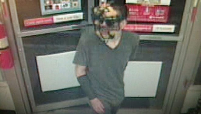 Police are looking for a man wearing a baseball umpire's mask who robbed a Turkey Hill in Dover Township.