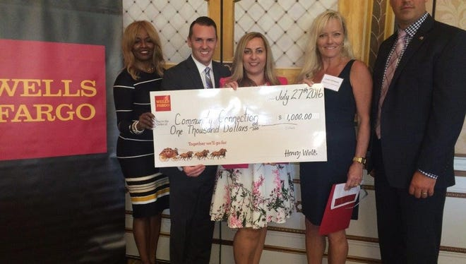 Wells Fargo region President Brenda Ross-Dulan (left), is with Wells Fargo Burlington County District Manager Kevin Rankin, Wells Fargo Mount Laurel store manager Anna Perryman, Lenape PTO president Linda Schwartz, and Wells Fargo South Jersey area President James Newson on July 27. Wells Fargo presented the Lenape PTO with a $1,000 check.