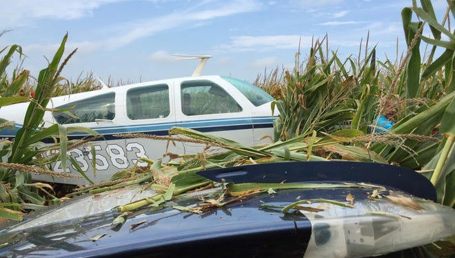 Two people were unharmed after a plane was forced to make an emergency landing north of the Sioux Falls Regional Airport on Tuesday.