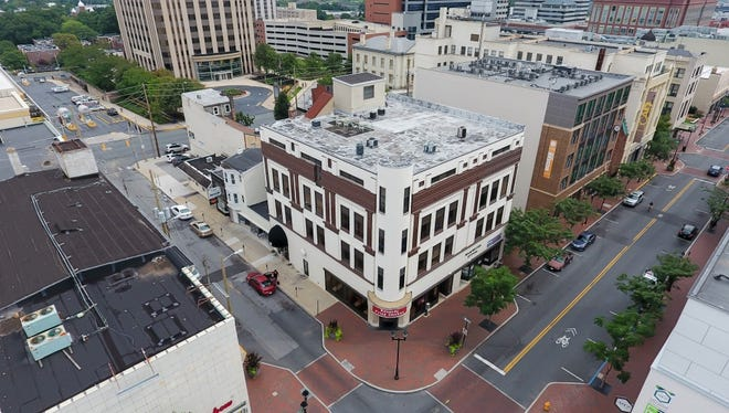 This four-story building at the corner of Market and Seventh streets in Wilmington is one of three properties The Buccini/Pollin Group plans to convert into apartments and retail space.