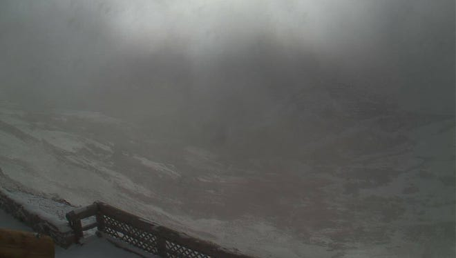 A webcam at Alpine Visitor Center shows a high-country snowstorm that temporarily closed Trail Ridge Road and Old Fall River Road in Rocky Mountain National Park on Saturday.
