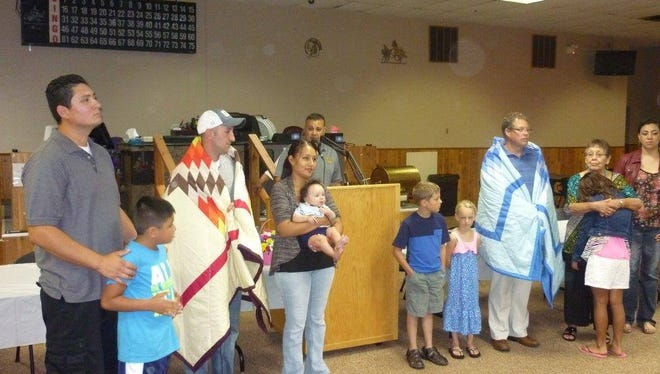 Jameson Bartscher and Todd Clausen are given star quilts from Sisseton Wahpeton Oyate Tribe for their actions in saving members of the tribe from a burning car in June 2015. The SD Highway Patrol also presented the men with Life Saving Awards.