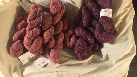 The lighter, dusty rose yarn on the left is the yarn I bought Friday at the North Jersey Fiber Arts Festival. The yarn on the right is the cranberry yarn I bought from Kris Byrnes at the Garden State Sheep & Wool Festival.