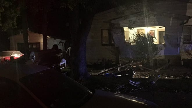 Police were pursuing suspects in a stolen car Oct. 11, 2016, when it struck a home near the corner of Michigan Street and Grant Avenue on the city's east side, according to Indianapolis Metropolitan Police Department Officer Jim Gillespie.