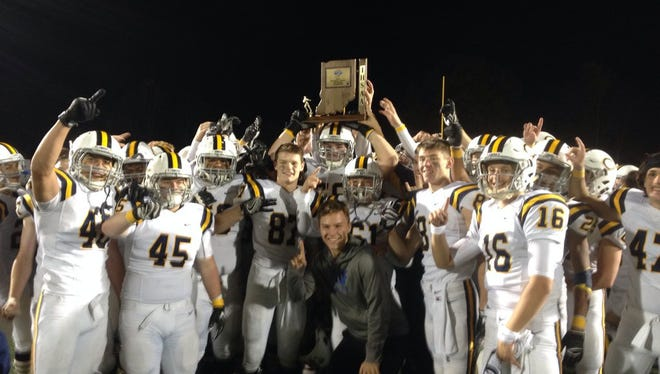 The Castle Knights celebrate winning the Class 5A Sectional 16 title Friday night.
