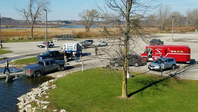 Kewaunee and Door county emergency personnel were stationed at the Kewaunee City Marina boat launch Monday morning as part of a search for a missing Green Bay fisherman.