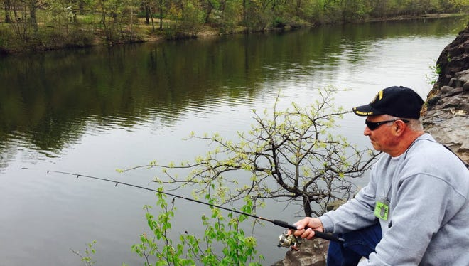 Long-time local angler George Rosa goes for trout at Barbour Pond in Garret Mountain Reservation in Paterson earlier this year.