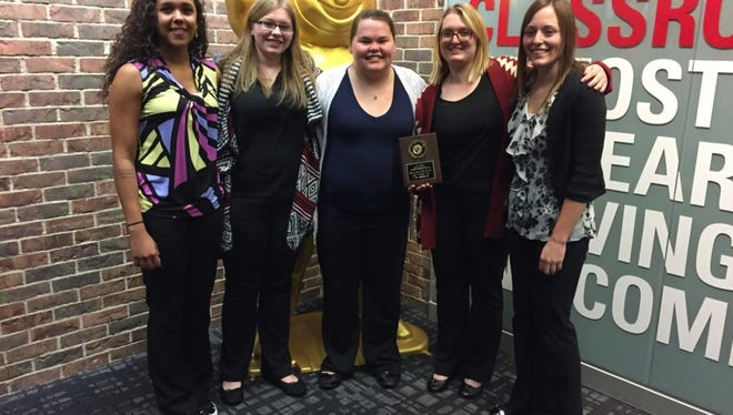 The UW-River Falls Animal Welfare Judging Team included (L-R): Kaleiah Schiller, Sarah Heck, Sara Odegard, Ashley Bue and Faith Baier.
