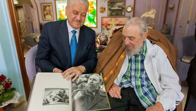 A handout picture shows Algerian Prime Minister Abdelmalek Sellal during a visit to Cuban former president Fidel Castro at the latter's home in Havanna, on Oct. 13, 2016